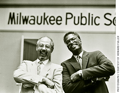 Howard Fuller with Bob Peterkin (left), the outgoing superintendent of the Milwaukee Public Schools, on the night in 1991 that Fuller was named the district's new superintendent