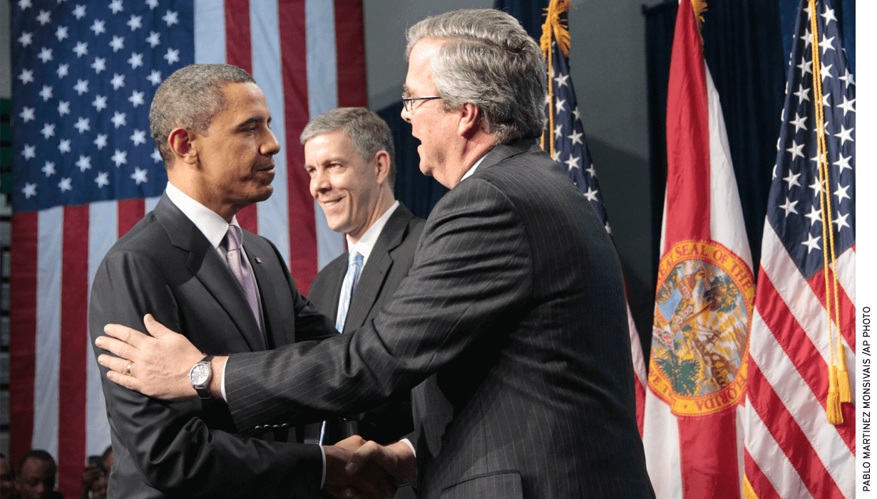 President Obama is introduced by former Florida Gov. Jeb Bush, right, before speaking at Miami Central Senior High School in 2011. Education Secretary Arne Duncan is at center.