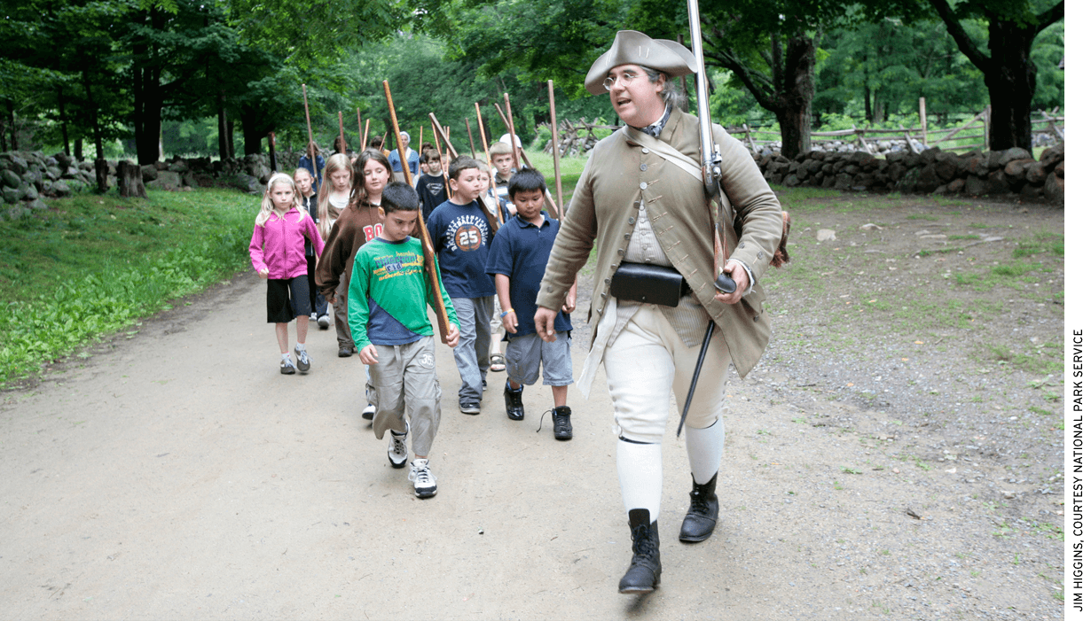 Park Ranger Jim Hollister leads a school group at Minute Man National Historical Park in Massachusetts.