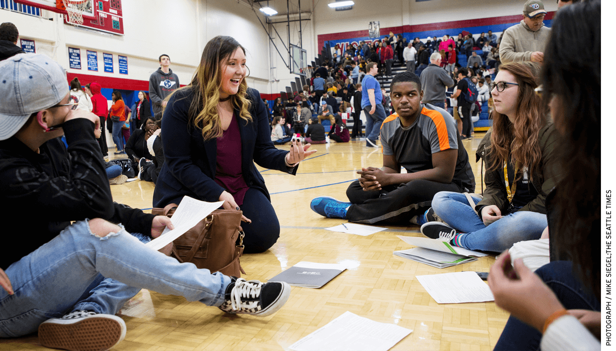 Karla MacIntyre, an admissions counselor at Lipscomb University in Nashville, is one of many mentors assigned to students during an evening at Nashville's McGavock High.