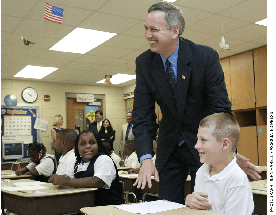 Mayor Bart Peterson visits with 3rd graders during the first day of classes in 2002 at Christel House Academy, a charter school.