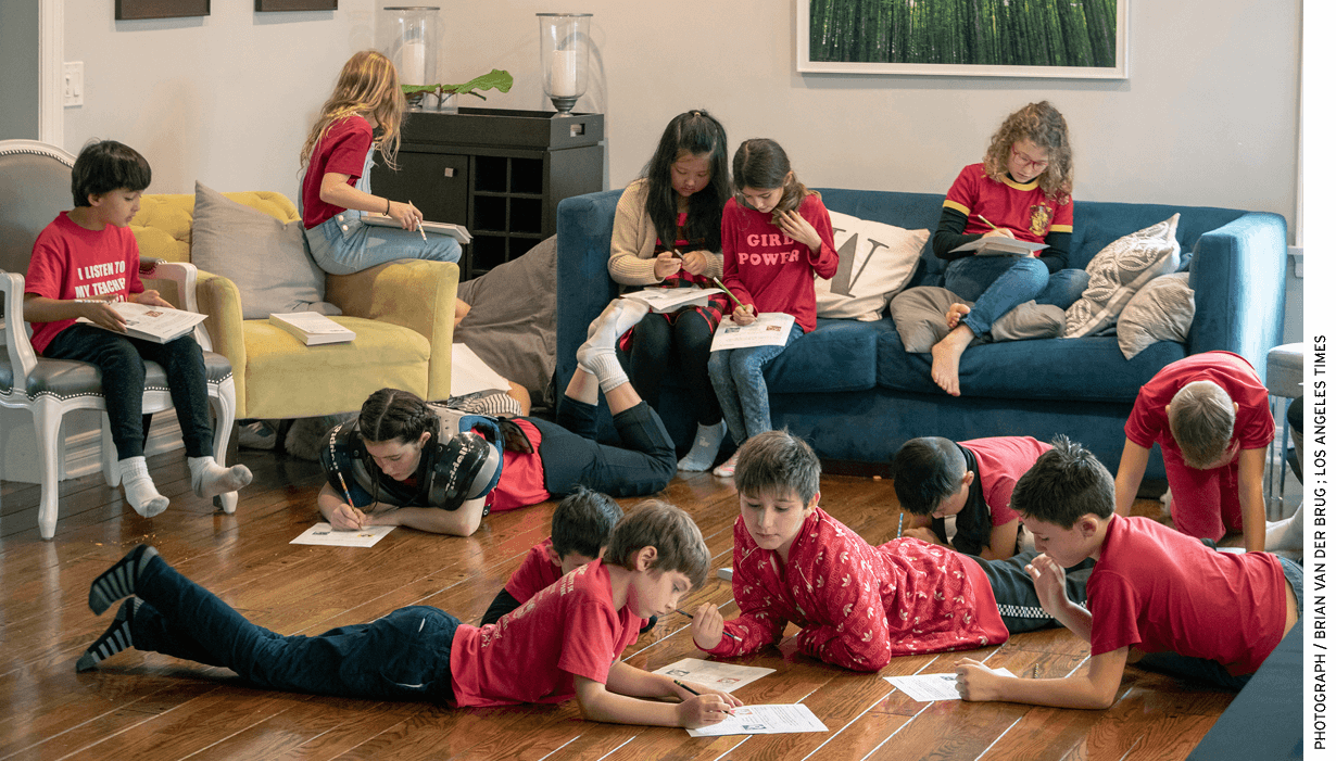 """Students from L.A. Unified's Encino Charter Elementary School —dressed in red to support their teachers—attended a community- organized """"strike school"""" in an Encino, Calif., home. Parents took turns hosting children during the teacher strike."""