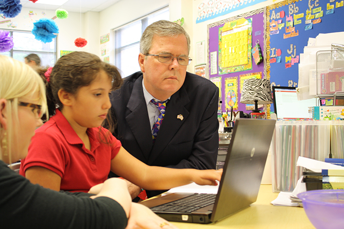 Governor Bush with a student during a visit to Reasoning Mind Photo: Joe Burbank / Courtesy Foundation for Excellence in Education