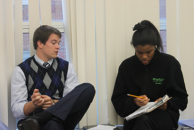 At Match High School, tutor Mike Francke works with a senior on her pre-calculus homework Photo by Gretchen Ertl / Courtesy Match Education