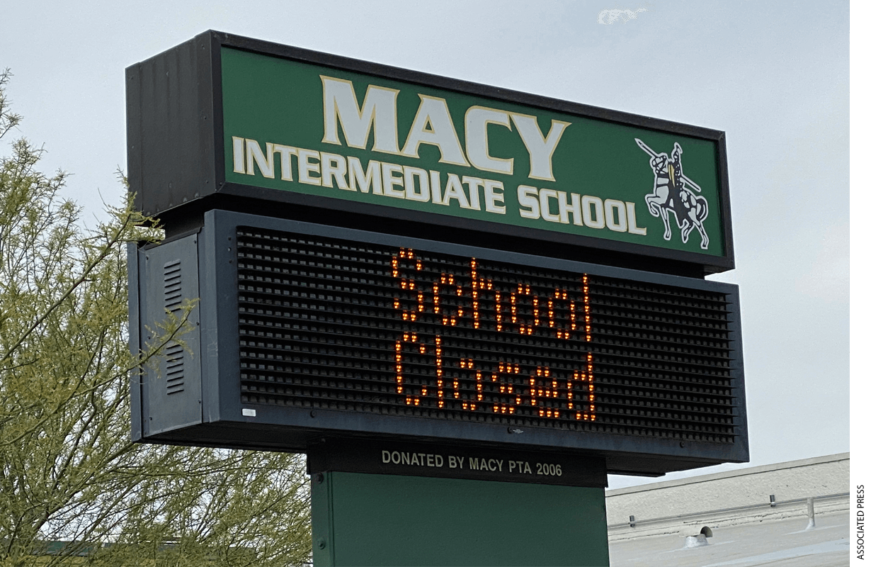 """School Closed"" sign at Macy Intermediate in the wake of the coronavirus COVID-19 pandemic outbreak, Wednesday, March 18, 2020, in Monterey Park, Calif."