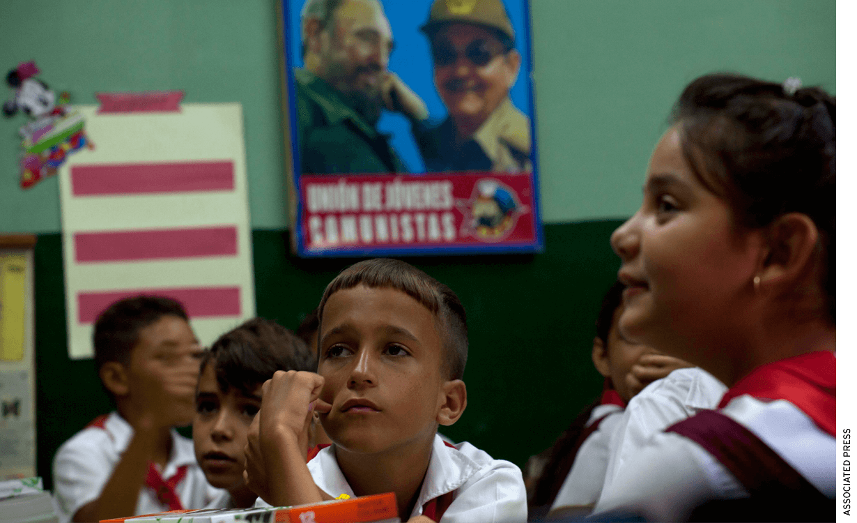Student Michael Aladro, 10, sits inside the classroom with fellow classmates on his first day back to school at the Angela Landa elementary school in Old Havana, Cuba.