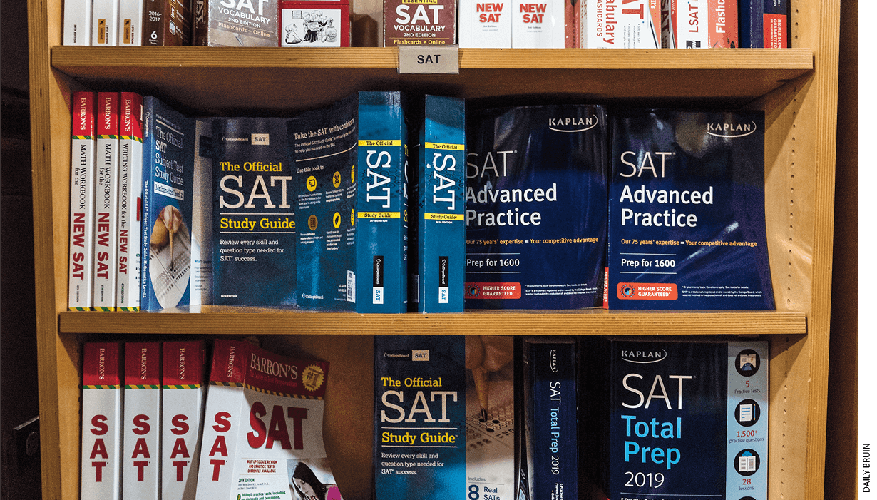 Several SAT preparation books on a bookshelf.