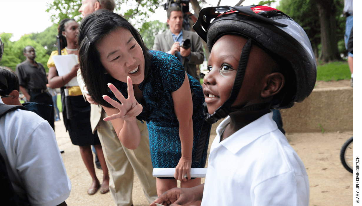 D.C. Public Schools Chancellor Michelle Rhee talked to Joshua Young, 4, during a walk-to- school event in Washington on August 24, 2010.